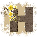 Yellow hibiscus vintage alphabet H Stock Image