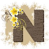 Yellow hibiscus vintage alphabet N. Yellow hibiscus grunge vintage alphabet N Stock Photos