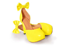 Yellow high heel shoes. With cute ribbon stock image