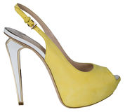 Yellow high heeled shoes Stock Photo