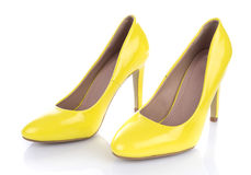 Yellow high heels shoes. Isolated on white royalty free stock images