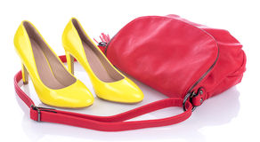 Yellow high heels shoes with red pink handbag Stock Photos