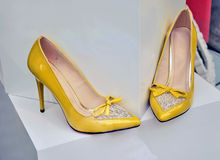 Yellow high heels Stock Images