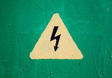 Yellow high voltage triangle warning sign Stock Images