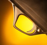 Yellow highlight. Black shotgun trigger and triggerguard with yellow behind Stock Photo