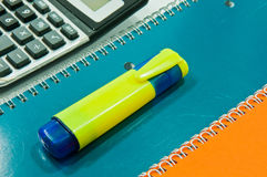 Yellow Highlighter on notebook Royalty Free Stock Photos