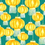 Yellow chinese lanterns sky lantern or Kongming lantern. Hand drawn watercolor illustration, bright yellow orange colors on soft green background, seamless Royalty Free Stock Photos