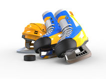 Yellow hockey equipment - skates with blue details and puck in front Royalty Free Stock Photos