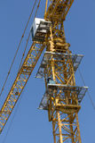Yellow hoisting crane isolate royalty free stock photography