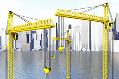 Yellow Hoisting Cranes Royalty Free Stock Photo