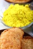 Yellow holi colors with gujiya at background Stock Photos