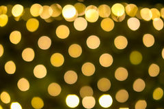 Yellow holiday festive bokeh. Christmas Abstract background Royalty Free Stock Image