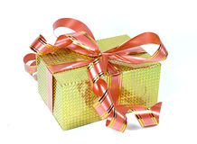 The yellow holographic gift box with bows Royalty Free Stock Photos