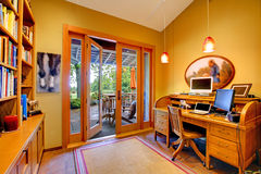 Yellow home office with an open door to the deck royalty free stock images