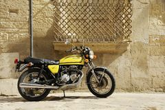Free Yellow Honda 400 Motorcycle Standing In The Street  Of Old Italian Town. Lecce, Apulia, Italy Stock Image - 162187371