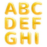 Yellow honey jelly alphabet. Glossy letters Stock Photo
