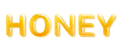 Yellow honey jelly word. Glossy letters Stock Photo
