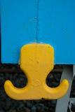 Yellow hook. Metal hook a wagon train Royalty Free Stock Image