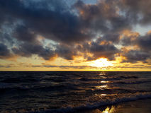 Yellow horizon and heavy clouds. During sunset on Baltic sea royalty free stock image