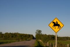 Horse Crossing Sign on a Rural Road Stock Photo
