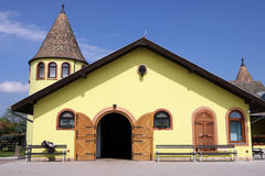 Yellow horse stable on farm Royalty Free Stock Image