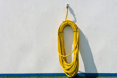 Yellow hose hanging Royalty Free Stock Images