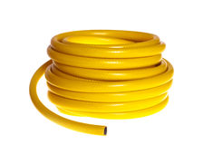 The yellow  hose on a white background (isolated). The yellow rubber garden hose on a white background (isolated). This photo is made in Moscow on July, 02 2009 Stock Images