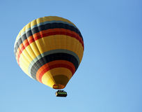 Yellow hot air ballon with colored bands Stock Photos