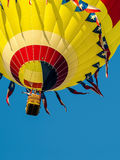 Yellow Hot Air Balloon. On Blue Sky royalty free stock images