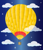 Yellow hot air balloon in flight Royalty Free Stock Image