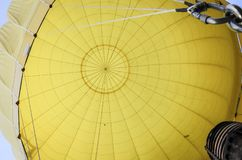 Yellow hot air baloon. From inside, fulll of hot air stock images