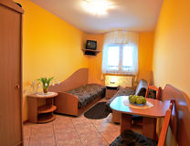 Yellow hotel bedroom Stock Image