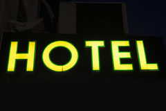 Yellow hotel sign. Over black background Stock Photo