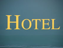 Yellow Hotel Text Sign on Green Canvas Stock Photos