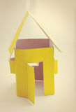 Yellow house  ​​of cardboard. Handmade yellow house  ​​of cardboard Royalty Free Stock Image