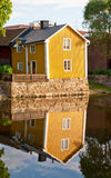 Yellow House. A reflection of a yellow house near Arboga river, Sweden Stock Photo