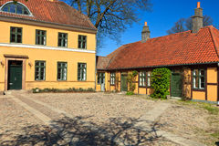 Yellow house. Traditional yellow house and annexe on a cobbled street in Roskilde Denmark Stock Images