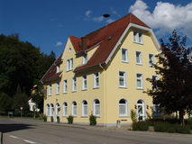 Yellow House. A big yellow house with a red hip roof in the southern part of Germany near the Swiss border Stock Photos