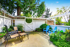 Yellow house backyard area with patio Royalty Free Stock Photography