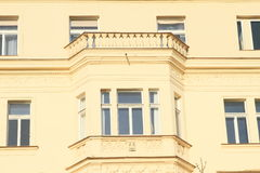 Yellow house with balcony Royalty Free Stock Images