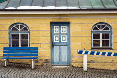 Yellow house with blue bench Stock Photo