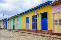 Yellow house with blue door and windows in Trinidad, Cuba Stock Images