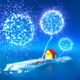 Yellow house on a blue island. Romantic scene with firework-trees and small yellow house Stock Photography