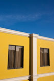 Yellow house and blue sky Royalty Free Stock Photography