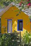 Yellow house with blue window, typical colorful of Trancoso Royalty Free Stock Photos