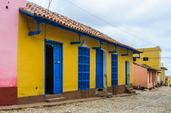 Yellow house with blue windows in Trinidad, Cuba Royalty Free Stock Photo
