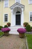 Yellow house with brick sidewalk Royalty Free Stock Photo