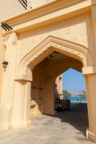Yellow house facade with classical Arabic arch Royalty Free Stock Photos