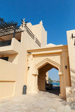 Yellow house facade fragment with classical Arabic arch Royalty Free Stock Photos