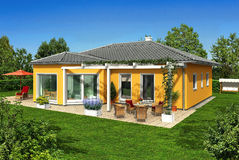 Yellow house in the garden Royalty Free Stock Photo